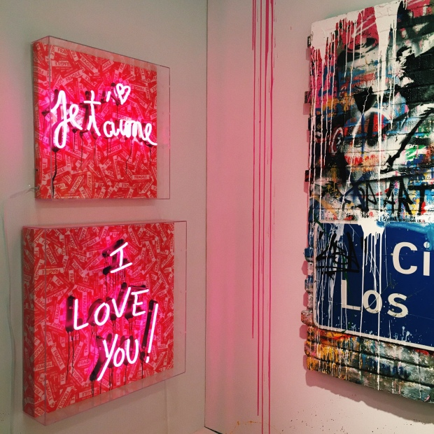 Je'Taime I Love You written in pink neon lights on canvas