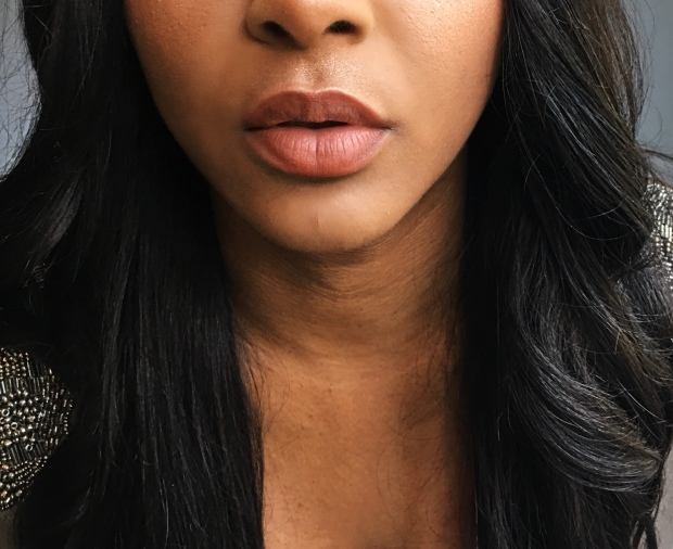 A close up of black beauty blogger, Diva Named Dom's nude lip.