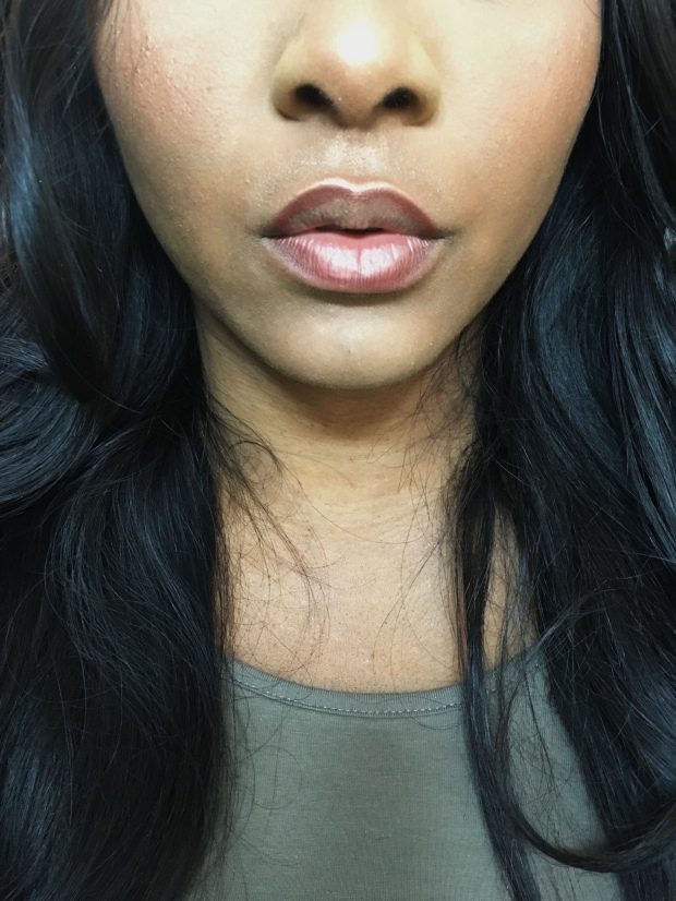 Black beauty blogger wearing Rimmel Coffee Bean Lip Liner before applying nude lipstick