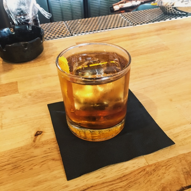 Traditional Knob Creek with oversized ice cube and lemon zest