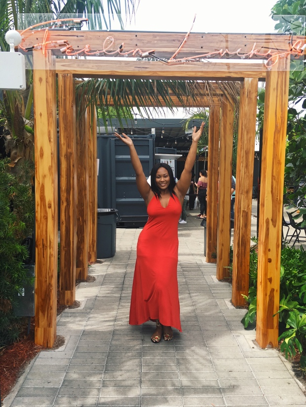 Lifestyle blogger, Diva Named Dom, in front of 1-800-Lucky in Wynwood, Miami, Florida