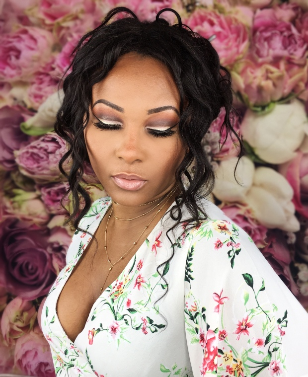 African American Beauty Blogger wearing Anastasia Beverly Hills Soft Glam Spring glitter cut crease eyeshadow on floral background