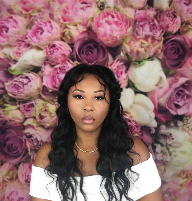 African American Beauty Blogger wearing Anastasia Beverly Hills Soft Glam Palette rose gold glam on floral background
